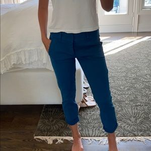 Teal jeans with rolled bottom